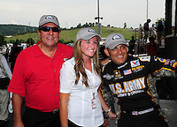 Jun. 17, 2012; Bristol, TN, USA: NHRA top fuel dragster driver Tony Schumacher (right) celebrates with father Don Schumacher (left) and sister Megan Fessel after winning the Thunder Valley Nationals at Bristol Dragway. Mandatory Credit: Mark J. Rebilas-