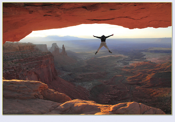 Photoshop. This visitor was jumping up and down on top of the arch. <br /> He looks much better as a BASE jumper.