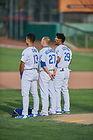 Ogden Raptors Marcus Chiu (13), Wes Helsabeck (27) and Jefrey Souffront (29) stand for the national anthem before a game against the Great Falls Voyagers at Lindquist Field on August 22, 2018 in Ogden, Utah. Great Falls defeated Ogden 3-1. (Stephen Smith/Four Seam Images)