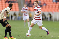 Houston, TX - Friday December 11, 2016: Sam Werner (23) of the Stanford Cardinal brings the ball up the field against the Wake Forest Demon Deacons at the NCAA Men's Soccer Finals at BBVA Compass Stadium in Houston Texas.