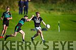 Ardferts Earnán Ferris been tackled by Churchill's Sean Donnellan in the St Brendan's Board Senior Championship semi final