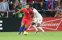 ORLANDO, FL - NOVEMBER 15: Sebastian Lletget #17 of the United States moves with the ball past Alphonso Davies #12 of Canada during a game between Canada and USMNT at Exploria Stadium on November 15, 2019 in Orlando, Florida.