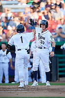 Kane County Cougars second baseman Jancarlos Cintron (1) is congratulated by left fielder Ryan Grotjohn (33) after hitting a home run in the bottom of the second inning during a game against the West Michigan Whitecaps on July 19, 2018 at Northwestern Medicine Field in Geneva, Illinois.  Kane County defeated West Michigan 8-5.  (Mike Janes/Four Seam Images)