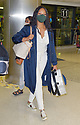 Garcelle Beauvais Sighted at Miami International Airport - July 15, 2021