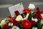"""© Joel Goodman - 07973 332324 . 28/08/2015 . Salford , UK . Flowers and tribute left on Sedan Close in Salford , from where the procession sets off . The funeral of Paul Massey at St Paul's CE Church in Salford . Massey , known as Salford's """" Mr Big """" , was shot dead at his home in Salford last month . Photo credit : Joel Goodman"""