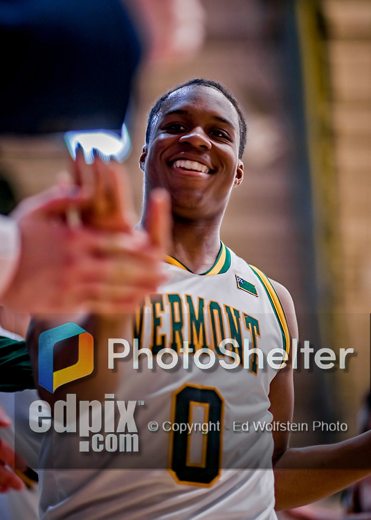 12 March 2019: University of Vermont Catamount Guard Stef Smith, a Sophomore from Ajax, Ontario, is all smiles as he returns to the bench in the second half against the Binghamton University Bearcats at Patrick Gymnasium in Burlington, Vermont. Smith set the America East Semifinal record with eight three-pointers, finishing his historic night with a career-high 28 points, as the top-seeded Catamounts advanced to their fourth-straight AE conference championship game, defeating the Bearcats 84-51. Mandatory Credit: Ed Wolfstein Photo *** RAW (NEF) Image File Available ***