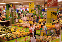 Locals shop at tesco on a sunday afternoon in Shenyang, China. The British retailer is undergoing an aggressive expansion and attempting to capture the growing middle class market in food and other domestic merchandise in China..