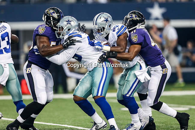 Dallas Cowboys running back Joseph Randle (21) and Baltimore Ravens defensive back Anthony Levine (41) in action during the pre-season game between the Baltimore Ravens and the Dallas Cowboys at the AT & T stadium in Arlington, Texas. Baltimore defeats Dallas  37-30.
