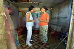 """THIS PHOTO IS AVAILABLE AS A PRINT OR FOR PERSONAL USE. CLICK ON """"ADD TO CART"""" TO SEE PRICING OPTIONS.   Ljatife Sikovska (left) is director of Ambrela, a grassroots Roma women's organization in Suto Orizari, the Macedonian municipality that is Europe's largest Roma settlement. Here she talks with a woman in her home in Suto Orizari about the woman's lack of sufficient legal documents, a common headache for Roma in Macedonia."""