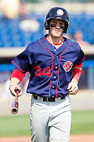 Bryce Harper #34 of the Hagerstown Suns jogs back to the dugout after scoring a run against the Rome Braves at State Mutual Stadium on May 2, 2011 in Rome, Georgia.   Photo by Brian Westerholt / Four Seam Images