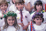 Castleton Garland Day Castleton Derbyshire UK May 29th. Schoolchildren taking party in parade. Flowers in hair. 1980s.