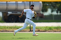 FCL Tigers West outfielder Roberto Campos (24) tracks a fly ball during a game against the FCL Yankees on July 31, 2021 at Tigertown in Lakeland, Florida.  (Mike Janes/Four Seam Images)