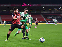 12th January 2021; Vitality Stadium, Bournemouth, Dorset, England; English Football League Championship Football, Bournemouth Athletic versus Millwall; Jed Wallace of Millwall competes for the ball with Lloyd Kelly of Bournemouth