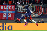 Serge Aurier of Tottenham Hotspur and Angelino of RB Leipzig during RB Leipzig vs Tottenham Hotspur, UEFA Champions League Football at the Red Bull Arena on 10th March 2020