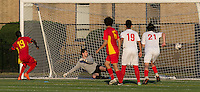 Malden, Massachusetts - June 26, 2016:  In a National Premier Soccer League (NPSL) match, Boston City FC (white) defeated Rhode Island Reds FC (red/yellow), 3-2, at Brother Gilbert Stadium on Donovan Field.<br /> Penalty kick score by Isaac Nana Addai.