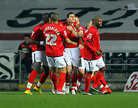 ATTENTION SPORTS PICTURE DESK<br /> Pictured: Graham Dorrans (C) of West Bromwich Albion mobbed by team mates celebrating his opening goal from the penalty spot<br /> Re: Coca Cola Championship, Swansea City Football Club v West Bromwich Albion at the Liberty Stadium, Swansea, south Wales. Tuesday 16 March 2010