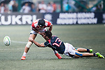 Tyler Spitz of Hong Kong (R) puts a tackle on Kanta Shikao of Japan (L) during the Asia Rugby Championship 2017 match between Hong Kong and Japan on May 13, 2017 in Hong Kong, China. Photo by Marcio Rodrigo Machado / Power Sport Images