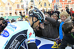 National hero Tom Boonen (BEL) Omega Pharma-Quickstep signs autographs before the start of the 96th edition of The Tour of Flanders 2012 in Bruges Market Square, running 256.9km from Bruges to Oudenaarde, Belgium. 1st April 2012. <br /> (Photo by Eoin Clarke/NEWSFILE).