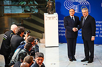 European Ceremony of Honour for Dr. Helmut KOHL, Former Chancellor of the Federal Republic of Germany and Honorary Citizen of Europe (1930 - 2017) at the European Parliament in Strasbourg - Handshake between Silvio BERLUSCONI, Former Italian Prime Minister, on the left, and Antonio TAJANI, EP President # CEREMONIE D'HOMMAGE A HELMUT KOHL AU PARLEMENT EUROPEEN