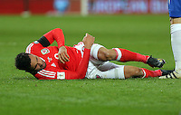 Hal Robson-Kanu of Wales rolls on the ground after getting injured during the 2018 FIFA World Cup Qualifier between Wales and Serbia at the Cardiff City Stadium, Wales, UK. Saturday 12 November 2016