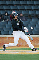 Matt Conway (25) of the Wake Forest Demon Deacons makes contact with the baseball during the game against the Georgetown Hoyas at Wake Forest Baseball Park on February 16, 2014 in Winston-Salem, North Carolina.  The Demon Deacons defeated the Hoyas 3-2.  (Brian Westerholt/Four Seam Images)