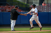 Illinois State Redbirds Danny Jackson (39) shakes hands with coach Mike Stalowy after hitting a home run during a game against the Bowling Green Falcons on March 11, 2015 at Chain of Lakes Stadium in Winter Haven, Florida.  Illinois State defeated Bowling Green 8-7.  (Mike Janes/Four Seam Images)