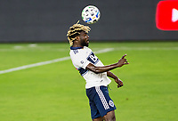 LOS ANGELES, CA - SEPTEMBER 23: Leonard Owusu #17 of the Vancouver Whitecaps with a head ball during a game between Vancouver Whitecaps and Los Angeles FC at Banc of California Stadium on September 23, 2020 in Los Angeles, California.