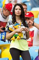 A Brazil fan with her Sonhador World Cup Mascot
