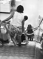 1966 File - <br /> <br /> Young mother takes big chance with child s safety here. If stroller wheels catch at bottom of escalator the baby may be thrown on floor.<br /> <br /> Photo : Boris Spremo - Toronto Star archives - AQP