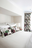 White beddings with floral pillows