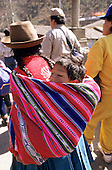 Paucartambo, Peru. Woman with baby in a manta on  her back.