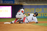 Scranton/Wilkes-Barre RailRiders shortstop Cito Culver (0) slides into second base as Mike Miller (10) applies the tag during a game against the Pawtucket Red Sox on May 15, 2017 at PNC Field in Moosic, Pennsylvania.  Scranton defeated Pawtucket 8-4.  (Mike Janes/Four Seam Images)