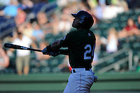 Second baseman Yoan Moncada of the Greenville Drive bats in a game against the Charleston RiverDogs on Sunday, June 28, 2015, at Fluor Field at the West End in Greenville, South Carolina. The Cuban-born 19-year-old Red Sox signee has been ranked the No. 1 international prospect in baseball by Baseball America. Charleston won, 12-9. (Tom Priddy/Four Seam Images)