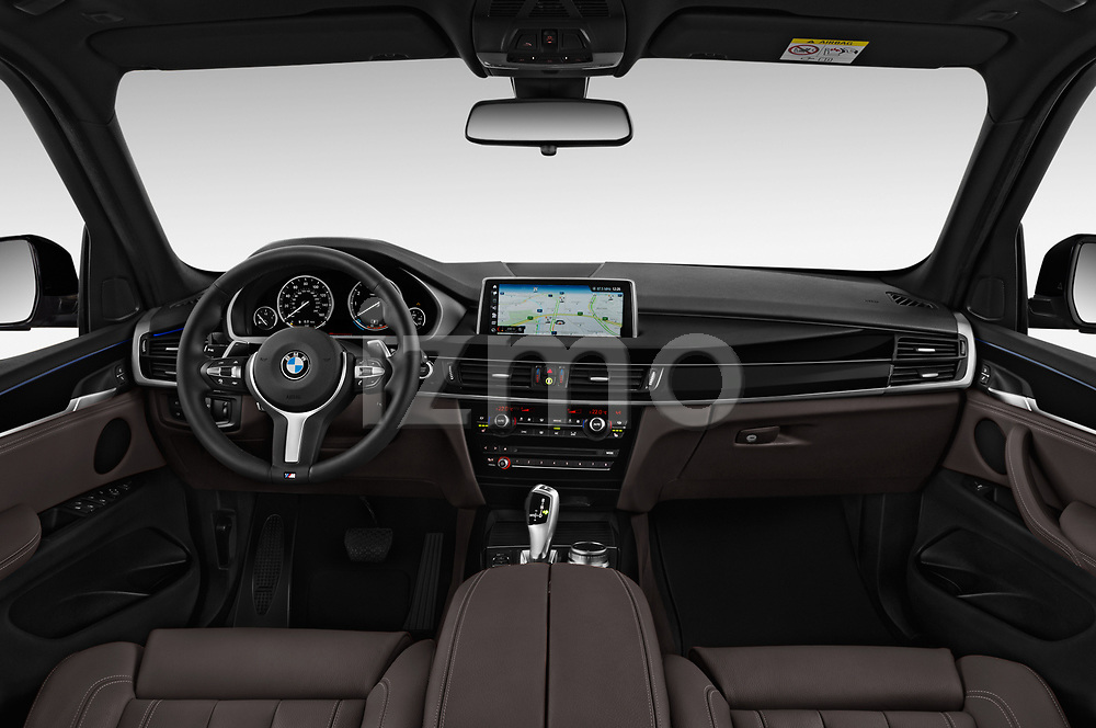 Stock photo of straight dashboard view of a 2018 BMW X5 xDrive40e 4WD 5 Door SUV