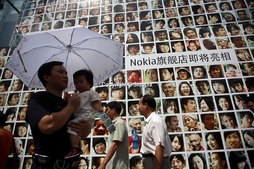 Pedestrians walks past a Nokia store under renovation in Shanghai, China..