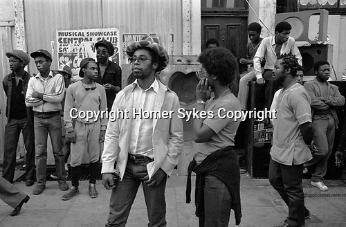 Black British teenagers 1980s UK hanging out  around a Reggae Sound System Notting Hill Carnival 1981 England