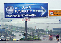 "A road sign shows the way to the ""Future City"" in Chongqing. Chongqing, the countries largest city and the gateway to western China, is undergoing an astounding building spree and being transformed from an old-style in-land city to a megalopolis..12-APR-0"