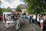 """© Joel Goodman - 07973 332324 . 28/08/2015 . Salford , UK . The procession arrives at the church  . The funeral of Paul Massey at St Paul's CE Church in Salford . Massey , known as Salford's """" Mr Big """" , was shot dead at his home in Salford last month . Photo credit : Joel Goodman"""