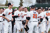 Oregon State Beavers celebrate a walk-off victory after a game against the New Mexico Lobos on February 15, 2019 at Surprise Stadium in Surprise, Arizona. Oregon State defeated New Mexico 6-5. (Zachary Lucy/Four Seam Images via AP)