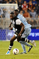 Shola Ameobi Newcastle United (black & white) in action... Sporting Kansas City and Newcastle United played to a 0-0 tie in an international friendly at LIVESTRONG Sporting Park, Kansas City, Kansas.