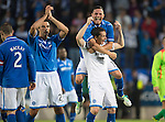 St Johnstone v Rosenborg....25.07.13  Europa League Qualifier<br /> Rory Fallon, Gary Miller and Gary McDonald celebrate at full time<br /> Picture by Graeme Hart.<br /> Copyright Perthshire Picture Agency<br /> Tel: 01738 623350  Mobile: 07990 594431
