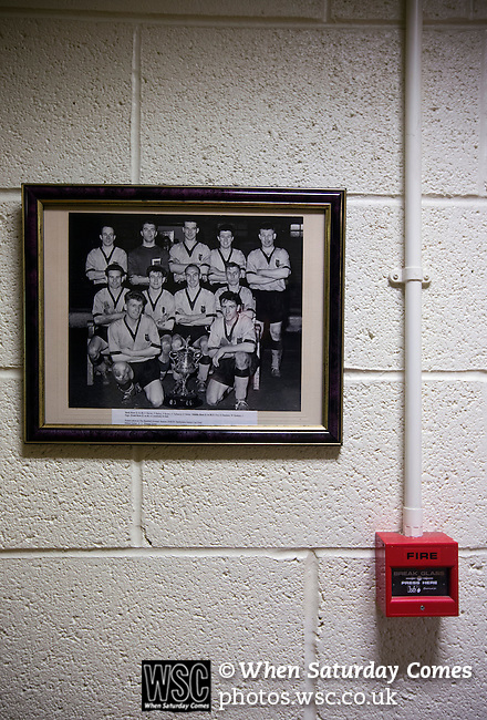 Belper Town v Gresley, 28/01/2014. Christchurch meadow, Northern Premier League. An historical team photograph showing the home team with the Derbyshire Senior Cup in 1959 hanging on a corridor wall outside the board room before Belper Town's match against Gresley, in a Northern Premier League, first division south fixture at Christchurch meadow. The home side have played at their current ground since the club was reformed in 1951. Belper won this fixture against their local Derbyshire rivals by 4 goals to 1 watched by a crowd of 165 spectators. Photo by Colin McPherson.