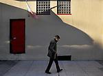 A man with cane walks down Green Street in Northbeach near Grant Street in San Francisco, CA..