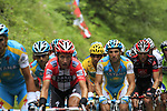 The peloton including Yellow Jersey Alberto Contador (ESP) Astana approach the summit of the Cat 1 climb at Col du Marie Blanque during a wet foggy Stage 17 of the 2010 Tour de France running 174km from Pau to Col du Tourmalet, France. 22nd July 2010.<br /> (Photo by Eoin Clarke/NEWSFILE).<br /> All photos usage must carry mandatory copyright credit (© NEWSFILE | Eoin Clarke)