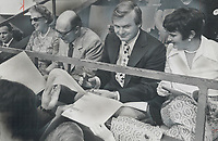Conservative autographs. Mr. and Mrs. Robert Stanfield; left; seated beside Ontario Premier William Davis and his wife Kathleen; are kept busy signing autographs during the Canada Soviet Union hockey game at Maple Leaf Gardens in Toronto last night. Stanfield; leader of the federal Progressive Conservatives; found time to talk politics.<br /> <br /> Photo : Boris Spremo - Toronto Star archives - AQP