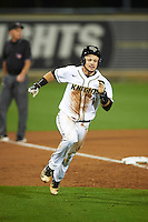 UCF Knights catcher Logan Heiser (1) running the bases during a game against the Siena Saints on February 17, 2017 at UCF Baseball Complex in Orlando, Florida.  UCF defeated Siena 17-6.  (Mike Janes/Four Seam Images)