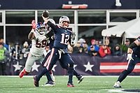 FOXBORO, MA - OCTOBER 10: New York Giants Offensive linemaner Lorenzo Carter (59) reaches for the ball as New England Patriots Quarterback Tom Brady (12) passes during a game between New York Giants and New England Patriots at Gillettes on October 10, 2019 in Foxboro, Massachusetts.