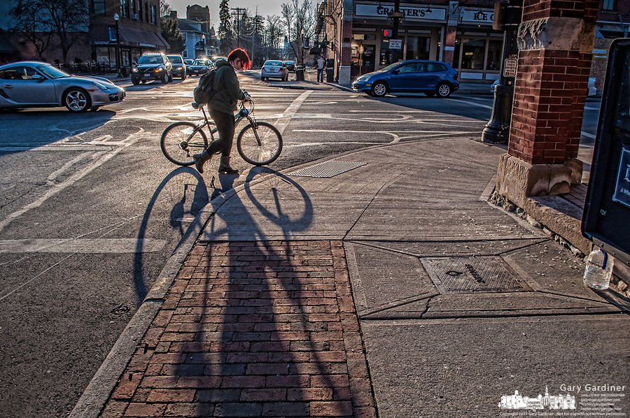 Bicyclist in afternoon sun in Uptown Westerville