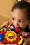 5 month old baby girl holding and biting toy