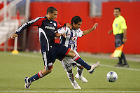 Pachuca CF midfielder Luis Montes (15) and New England Revolution defender Amaechi Igwe (2). The New England Revolution defeated Pachuca CF 1-0 during a Group B match of the 2008 North American SuperLiga at Gillette Stadium in Foxborough, Massachusetts, on July 16, 2008.